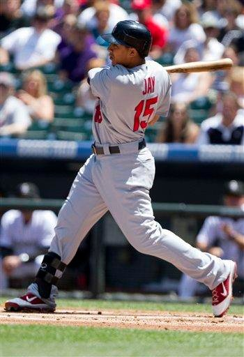 St. Louis Cardinals' Jon Jay (15) hits a two-run homer off of Colorado Rockies starting pitcher Jhoulys Chacin, scoring Ryan Theriot, during the first inning of a baseball game Sunday, May 29, 2011 in Denver. (AP Photo/Barry Gutierrez) By Barry Gutierrez