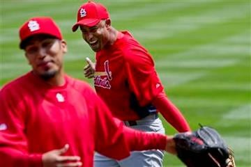 St. Louis Cardinals' Fernando Salas, left, and Miguel Batista, right, warm up with a ball before a baseball game against the Colorado Rockies, Sunday, May 29, 2011, in Denver. (AP Photo/Barry Gutierrez) By Barry Gutierrez