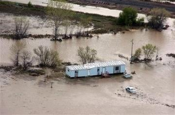 A flooded mobile home near Crow Agency, Mont. is seen Friday May 27, 2011. Recent flooding displaced hundreds of residents of the Crow Indian Reservation and damaged an estimated 200 homes. (AP Photo/Matthew Brown) By Matthew Brown