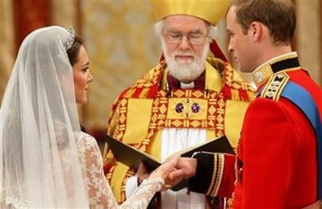Kate Middleton and and Britain's Prince William hold hands during the wedding service at Westminster Abbey, conducted by the Archbishop of Canterbury Dr Rowan Williams, London, Friday April 29, 2011. (AP Photo/Dave Thompson, Pool) By Dave Thompson
