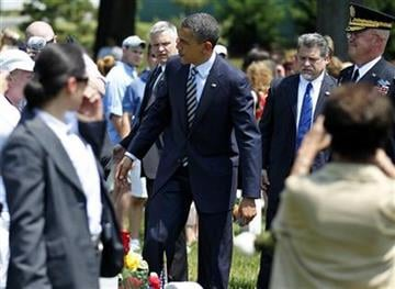 President Barack Obama speaks with family of a fallen soldier on Memorial Day in Section 60 of Arlington National Cemetery Monday, May 30, 2011.(AP Photo/Jose Luis Magana) By Jose Luis Magana