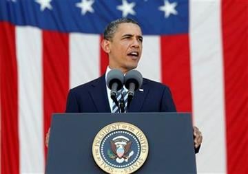 President Barack Obama speaks at the Memorial Day ceremony at the amphitheater at Arlington National Cemetery, Monday, May 30, 2011. (AP Photo/Charles Dharapak) By Charles Dharapak