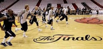 Dallas Mavericks players run the court during an NBA Finals basketball practice Monday, May 30, 2011, in Miami. The Mavericks will play the Miami Heat in Game 1 of the NBA Finals Tuesday. (AP Photo/David J. Phillip) By David J. Phillip