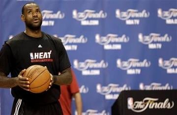 Miami Heat's LeBron James waits to shoot during an NBA Finals basketball practice Monday, May 30, 2011, in Miami. The Dallas Mavericks will play the Heat in Game 1 of the NBA Finals Tuesday. (AP Photo/David J. Phillip) By David J. Phillip