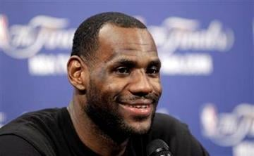 Miami Heat's LeBron James smiles as he answers a question after an NBA Finals basketball practice Monday, May 30, 2011, in Miami. The Dallas Mavericks will play the Heat in Game 1 of the NBA Finals Tuesday. (AP Photo/David J. Phillip) By David J. Phillip
