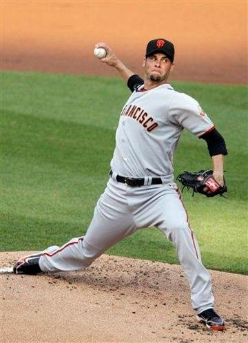 San Francisco Giants starting pitcher Ryan Vogelsong throws against the St. Louis Cardinals in the first inning of a baseball game, Tuesday, May 31, 2011 in St. Louis.(AP Photo/Tom Gannam) By Tom Gannam