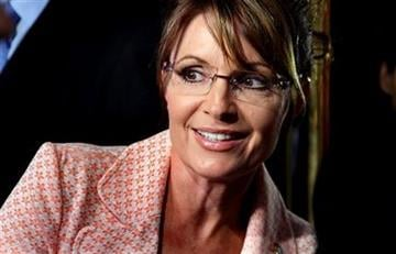 Former governor of Alaska Sarah Palin looks back at a crowd as she walks to the door of Tump Tower for a scheduled meeting with Donald Trump in New York Tuesday, May 31, 2011. (AP Photo/Craig Ruttle) By Craig Ruttle