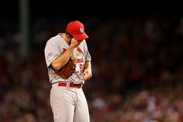 BOSTON, MA - OCTOBER 23:  Adam Wainwright #50 of the St. Louis Cardinals reacts against the Boston Red Sox during Game One of the 2013 World Series at Fenway Park on October 23, 2013 in Boston, Massachusetts.  (Photo by Rob Carr/Getty Images) By Rob Carr