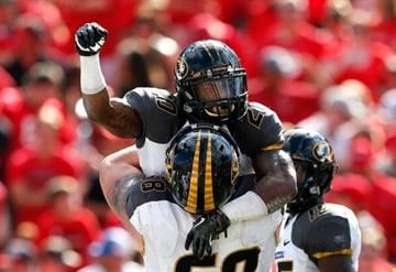 ATHENS, GA - OCTOBER 12:  Henry Josey #20 of the Missouri Tigers celebrates his touchdown against the Georgia Bulldogs with Justin Britt #68 at Sanford Stadium on October 12, 2013 in Athens, Georgia.  (Photo by Kevin C. Cox/Getty Images) By Kevin C. Cox