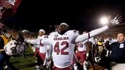 South Carolina's Jordan Diggs celebrates his team's 27-24 overtime victory over Missouri as he walks off the field after  an NCAA college football game Saturday, Oct. 26, 2013, in Columbia, Mo. (AP Photo/L.G. Patterson) By L.G. Patterson