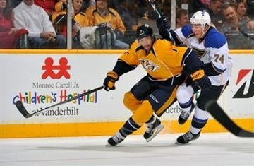 NASHVILLE, TN - OCTOBER 26:  T.J. Oshie #74 of the St. Louis Blues skates against Matt Cullen #7 of the Nashville Predators at Bridgestone Arena on October 26, 2013 in Nashville, Tennessee.  (Photo by Frederick Breedon/Getty Images) By Frederick Breedon