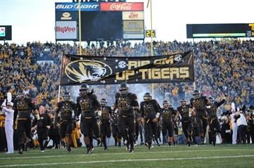 COLUMBIA, MO - OCTOBER 26:  The Missouri Tigers run onto the field before a game against the South Carolina Gamecocks October 26, 2013 at Faurot Field/Memorial Stadium in Columbia, Missouri.  (Photo by Peter Aiken/Getty Images) By Peter Aiken