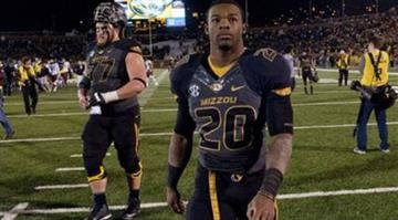 Missouri running back Henry Josey, right, walks off the field with teammate Evan Boehm, left, after the 27-24 loss to South Carolina in an NCAA college football game Saturday, Oct. 26, 2013, in Columbia, Mo. (AP Photo/L.G. Patterson) By L.G. Patterson