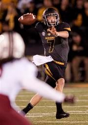 Missouri quarterback Maty Mauk, right, throws a pass over South Carolina's Kaiwan Lewis during the second quarter of an NCAA college football game Saturday, Oct. 26, 2013, in Columbia, Mo. (AP Photo/L.G. Patterson) By L.G. Patterson