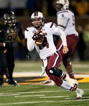 South Carolina quarterback Connor Shaw scrambles for yardage during the fourth quarter of an NCAA college football game against Missouri, Saturday, Oct. 26, 2013, in Columbia, Mo. South Carolina won 27-24. (AP Photo/L.G. Patterson) By L.G. Patterson