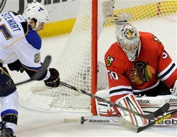 Chicago Blackhawks' goalie Corey Crawford (50) blocks a shot by St. Louis Blues' Chris Stewart (25)in the third period of an NHL hockey game Sunday April 14, 2013, in St. Louis. Chicago won 2-0.(AP Photo/Bill Boyce) By Bill Boyce