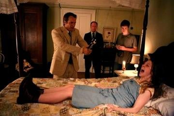 """In this publicity image released by Lionsgate, clockwise from left, Patrick Fabian, Louis Herthum, Caleb Landry Jones and Ashley Bell are shown in a scene from, """"The Last Exorcism."""" (AP Photo/Lionsgate, Patti Perret) By PATTI PERRET"""