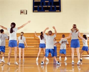 Group of teenagers (11-16) exercising at school gym, rear view By 102301.000000