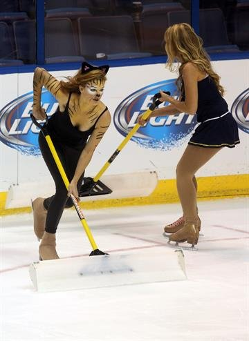 The St. Louis Blues ice crew dress in holloween costumes as they clean the ice in the first period of the Winnipeg Jets- St. Louis Blues hockey game at the Scottrade Center in St. Louis on October 29, 2013.    UPI/Bill Greenblatt By BILL GREENBLATT