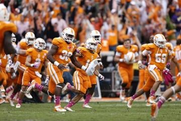 KNOXVILLE, TN - OCTOBER 19: Tennessee Volunteers players celebrate after the game against the South Carolina Gamecocks at Neyland Stadium on October 19, 2013 in Knoxville, Tennessee. Tennessee won 23-21. (Photo by Joe Robbins/Getty Images) By Joe Robbins