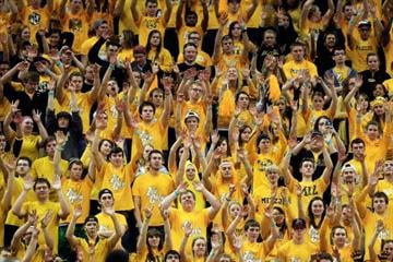 COLUMBIA, MO - MARCH 05:  Missouri Tigers fans raise their arms during a free throw during the game against the Arkansas Razorbacks at Mizzou Arena on March 5, 2013 in Columbia, Missouri.  (Photo by Jamie Squire/Getty Images) By Jamie Squire