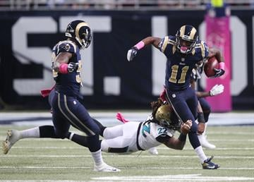 St. Louis Rams Tavon Austin just gets caught by Jacksonville Jaguars Winston Guy for the stop in the first quarter during a punt return at the Edward Jones Dome in St. Louis on October 6, 2013.   UPI/Bill Greenblatt By BILL GREENBLATT