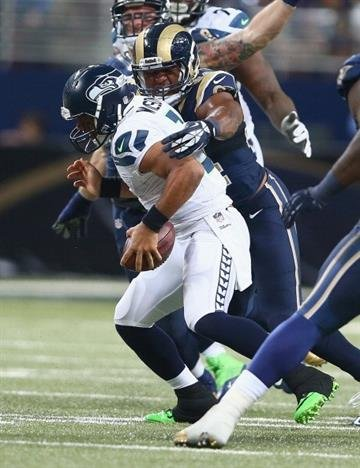 ST LOUIS, MO - OCTOBER 28:  Russell Wilson #3 of the Seattle Seahawks is sacked by Robert Quinn #94 of the St. Louis Rams during the game at Edward Jones Dome on October 28, 2013 in St Louis, Missouri.  (Photo by Andy Lyons/Getty Images) By Andy Lyons