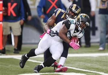St. Louis Rams Robert Quinn slows the progress of Jacksonville Jaguars Maurice Jones-Drew in the fourth quarter at the Edward Jones Dome in St. Louis on October 6, 2013. St. Louis won the game 34-20.   UPI/Bill Greenblatt By BILL GREENBLATT