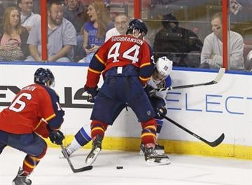 SUNRISE, FL - NOVEMBER 1: Erik Gudbranson #44 of the Florida Panthers checks Alexander Steen #20 of the St. Louis Blues along the boards at the BB&T Center on November 1, 2013 in Sunrise, Florida. (Photo by Joel Auerbach/Getty Images) By Joel Auerbach