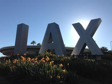 A Hillsboro father was delayed at LAX after a TSA agent is shot. He was trying to get home for his daughter's birthday. By Elizabeth Eisele