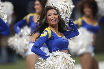 A St. Louis Rams cheerleader entertains the crowd during a game against the Tennessee Titans at the Edward Jones Dome in St. Louis on November 3, 2013.     UPI/Bill Greenblatt By BILL GREENBLATT