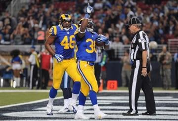 ST. LOUIS, MO - NOVEMBER 3: Zac Stacy #30 of the St. Louis Rams scores a second quarter touchdown against the Tennessee Titans at the Edward Jones Dome on November 3, 2013 in St. Louis, Missouri.  (Photo by Michael Thomas/Getty Images) By Michael Thomas