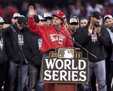 ST. LOUIS, MO - OCTOBER 30: Manager Tony LaRussa of the St. Louis Cardinals acknowledges the celebrating crowd inside Busch Stadium on October 30, 2011 in St Louis, Missouri. (Photo by Ed Szczepanski/Getty Images) By Ed Szczepanski