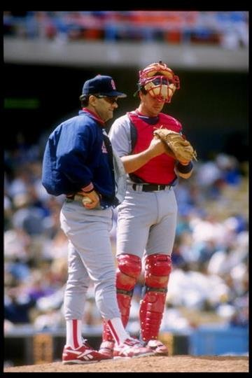 14 May 1995: Catcher Tom Pagnozzi of the St. Louis Cardinals (right) confers with manager Joe Torre during a game against the Los Angeles Dodgers at Dodger Stadium in Los Angeles, California. The Cardinals won the game 6-5. By Stephen Dunn