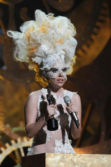LONDON, ENGLAND - FEBRUARY 16:  Lady Gaga accepts an award on stage at The Brit Awards 2010 at Earls Court on February 16, 2010 in London, England.  (Photo by Gareth Cattermole/Getty Images) By Gareth Cattermole
