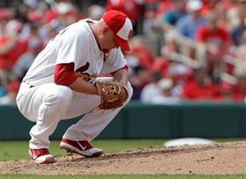 St. Louis Cardinals starting pitcher Kyle McClellan reacts to giving up a grand slam to San Francisco Giants' Andres Torres in the fourth inning of a baseball game, Monday, May 30, 2011 in St. Louis.(AP Photo/Tom Gannam) By Tom Gannam