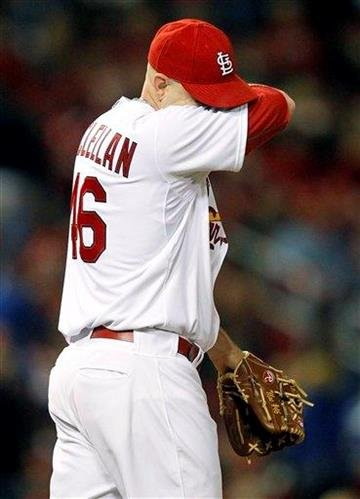 St. Louis Cardinals relief pitcher Kyle McClellan reacts after giving up a three-run home run to Chicago Cubs' Alfonso Soriano during the eighth  inning of a baseball game, Friday, Sept. 23, 2011, in St. Louis. (AP Photo/Jeff Roberson) By Jeff Roberson