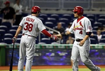 MIAMI, FL - JUNE 15:  Yadler Molina #4 of the St. Louis Cardinals celebrates scoring a run with teamate Pete Kozma #38 during the first inning at Marlins Park on June 15, 2013 in Miami, Florida.  (Photo by Marc Serota/Getty Images) By Marc Serota