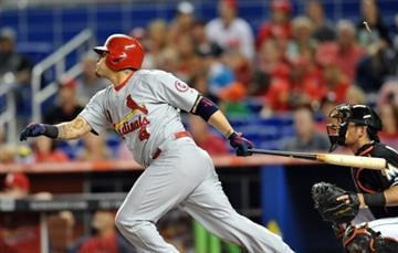 MIAMI, FL - JUNE 14:  Yadier Molina #4 of the St. Louis Cardinals connects for an RBI single during the first inning against the Miami Marlins at Marlins Park on June 14, 2013 in Miami, Florida. (Photo by Steve Mitchell/Getty Images) By Steve Mitchell