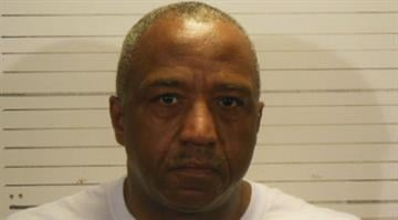 Douglas Young, 61, has been charged with official misconduct for bringing narcotics and prescription drugs to an inmate of the St. Clair County Jail. By Dan Mueller