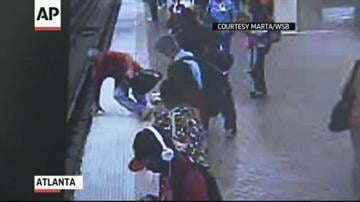 Newly released surveillance video captures the dramatic rescue of a man who tumbled onto railroad tracks as a subway train approached. Bystanders at Atlanta's Five Points Station formed a human chain to rescue him. (AP / Marta) By Bryce Moore