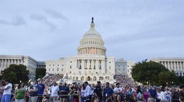 Guests attend the rehearsal for the 'A Capitol Fourth 2013 Independence Day Concert' on the West Lawn of the US Capitol on July 3, 2013 in Washington, DC. (Photo by Kris Connor/Getty Images for Capital Concerts) By Kris Connor