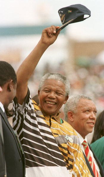 31 Jan 1996:  South Africa president Nelson Mandela salutes the crowd before the opening game of the African Cup of Nations in Johanassberg, South Africa. Mandatory Credit: Gary M. Prior/ALLSPORT By Gary M. Prior