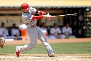OAKLAND, CA - JUNE 30:  Allen Craig #21 of the St. Louis Cardinals hits a home run in the first inning of their game against the Oakland Athletics at O.co Coliseum on June 30, 2013 in Oakland, California.  (Photo by Ezra Shaw/Getty Images) By Ezra Shaw