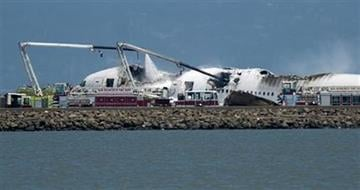 A fire truck sprays water on Asiana Flight 214 after it crashed at San Francisco International Airport on Saturday, July 6, 2013, in San Francisco. (AP Photo/Noah Berger) By Noah Berger