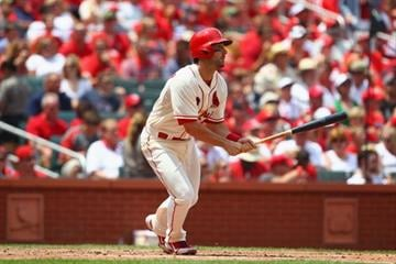 ST. LOUIS, MO - JULY 6: Matt Carpenter #13 of the St. Louis Cardinals hits an RBI triple against the Miami Marlins in the third inning at Busch Stadium on July 6, 2013 in St. Louis, Missouri. (Photo by Dilip Vishwanat/Getty Images) By Dilip Vishwanat