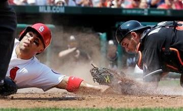 St. Louis Cardinals' Carlos Beltran, left, is safe at home for a stolen base ahead of the tag from Miami Marlins catcher Jeff Mathis during the third inning of a baseball game Sunday, July 7, 2013, in St. Louis. (AP Photo/Jeff Roberson) By Jeff Roberson