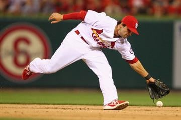 ST. LOUIS, MO - MAY 29: Pete Kozma #38 of the St. Louis Cardinals misplays a ground ball against the Kansas City Royals at Busch Stadium on May 29, 2013 in St. Louis, Missouri.  (Photo by Dilip Vishwanat/Getty Images) By Dilip Vishwanat