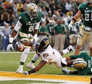 Missouri running back Henry Josey (20) scores past Baylor's Ahmad Dixon, left, and Mike Hicks in the first half of an NCAA college football game, Saturday, Nov. 5,  2011, in Waco, Texas. (AP Photo/Waco Tribune Herald, Jose Yau) By Jose Yau