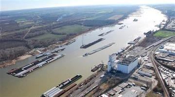 This Dec. 5, 2012 photo provided by The United States Coast Guard shows barges passing in tight quarters due to low water levels as they navigate the Mississippi River near St. Louis. (AP Photo/United States Coast Guard, Colby Buchanan) By Dan Mueller